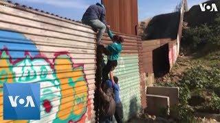 U.S. Border Patrol Detains Migrants Climbing Border Fence at Tijuana - VOAVIDEO