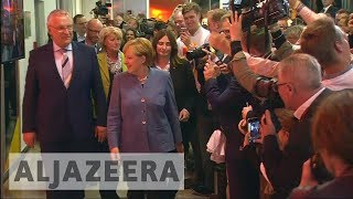 German elections: Angela Merkel wins fourth term as far-right AfD surges - ALJAZEERAENGLISH