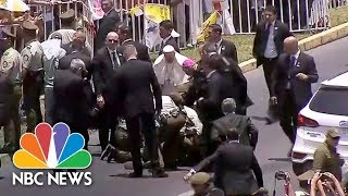 Pope Francis Stops Motorcade To Help Injured Police Officer | NBC News - NBCNEWS