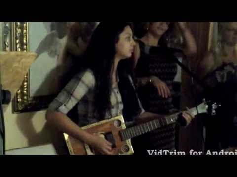 16 year old girl playing with cigar box guitar