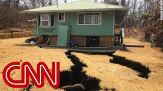 Giant cracks threaten to swallow home - CNN