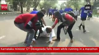Watch: GT Devegowda falls down while running in marathon - TIMESOFINDIACHANNEL