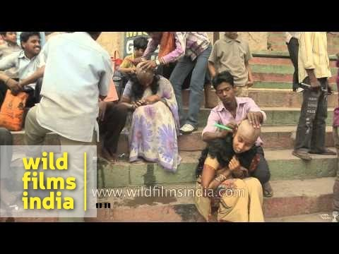 Women getting their heads shaved at the ghat of Varanasi