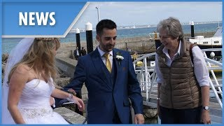 Awkward moment Theresa May gatecrashes couple's wedding in Italy - THESUNNEWSPAPER