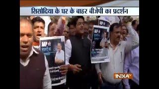 BJP workers protest outside Manish Sisodia's residence alleging attack in Delhi Secretariat - INDIATV