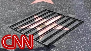 Street artist strikes again on Trump's Hollywood star - CNN