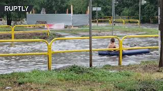 Air bed riding: Locals turn flood into a day of fun in Russia's Tolyatti - RUSSIATODAY