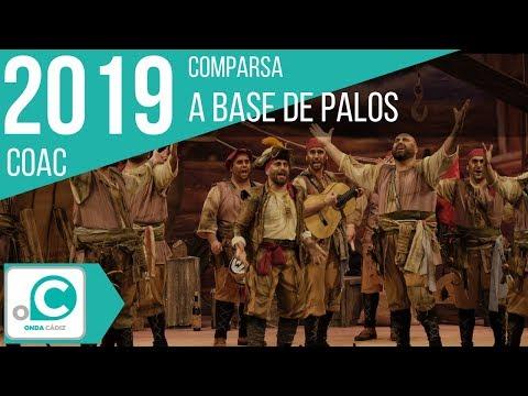 La agrupación A base de palos llega al COAC 2019 en la modalidad de Comparsas. En años anteriores (2018) concursaron en el Teatro Falla como Pueblo llano, consiguiendo una clasificación en el concurso de Semifinales.