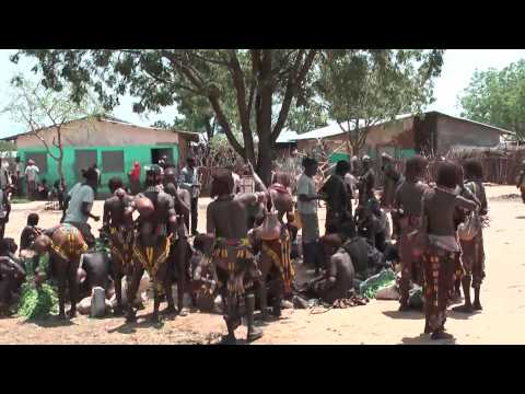 Hamer people and Karo tribe - native African tribes meet at Turmi market in Ethiopia