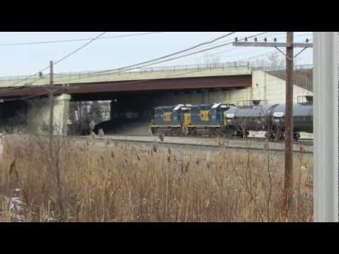 CSX Geeps switch cars with Amtrak Adirondack