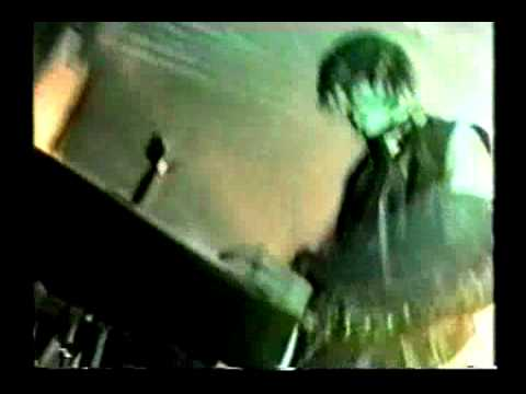 Trent Reznor showing a keyboard who's boss(Nine Inch Nails)
