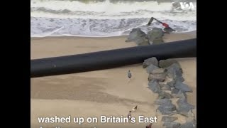Giant plastic pipes washed up on a beach in England - VOAVIDEO