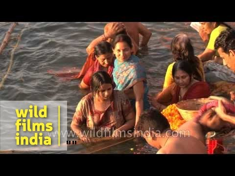 Hindu women bathe in the Ganges to observe Shivratri, Varanasi