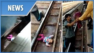Moment miracle baby lives after falling onto tracks and under a moving train in India - THESUNNEWSPAPER