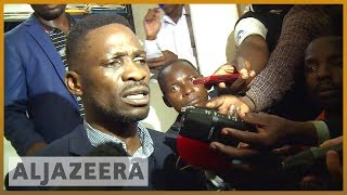 🇺🇬 Ugandan pop star MP Bobi Wine arrested on arrival l Al Jazeera English - ALJAZEERAENGLISH