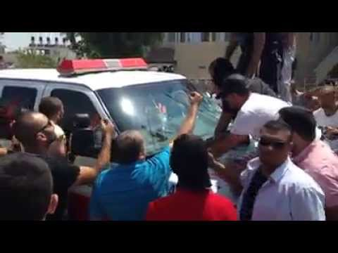 Arabs Smash Windows of PRCS Ambulance at Mohammed Abu Khdeir Funeral