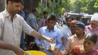 Hyderabad: Commuters given buttermilk to beat the heat - TIMESOFINDIACHANNEL