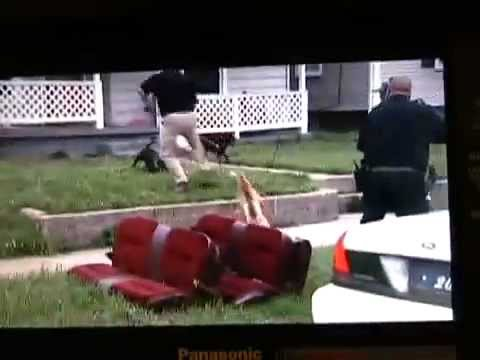 Pitbull Attacks a man and Cop Shoots Pitbull in the head