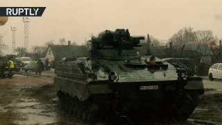 Dozens of German tanks arrive in Lithuania for NATO deployment - RUSSIATODAY