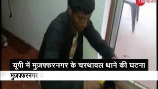 Accused seen mopping the floor in Muzaffarnagar's Charthawal Police Station - ZEENEWS
