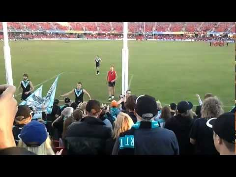 Port Adelaide fans celebrate after win over Gold Coast at Metricon Stadium, Round 9, 2012