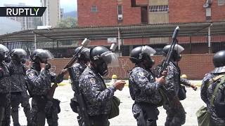 Months of chaos: Protesters clash with Caracas police after attempt to storm TV network offices - RUSSIATODAY