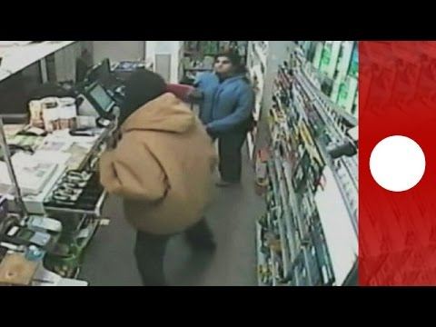 Female shopkeeper shows armed robbers who