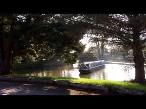 A Narrow boat manoeuvring a turning circle at Bridge 18 Macclesfield canal