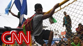 CNN reporter describes chaos amid the caravan - CNN