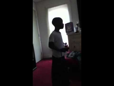 Kid almost hits girl with wii remote