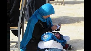 Photo of Afghan woman nursing her child during exam goes viral - ABPNEWSTV