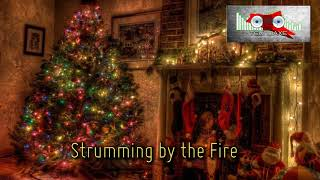 Royalty FreeHoliday:Strumming by the Fire