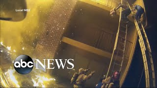 Helmet camera shows firefighters catching children thrown from burning building - ABCNEWS
