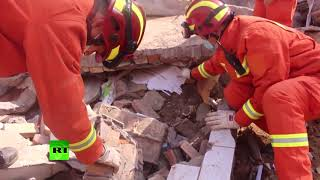 Two residential buildings collapse due to landslide in China: 15 dead, 13 rescued, 5 missing - RUSSIATODAY