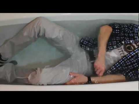 in the bathtube wearing A&F clothes, levis 551 jeans, puma suede sneaks....