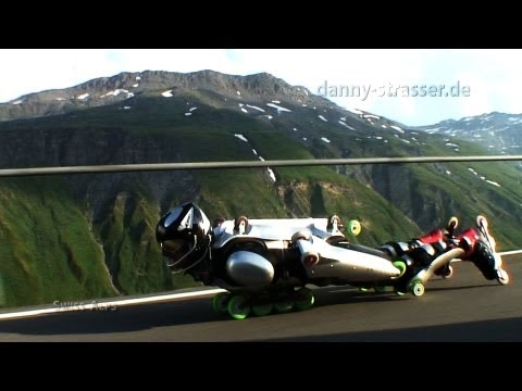 Downhill extreme: Rollerman overtaking motorcycle!