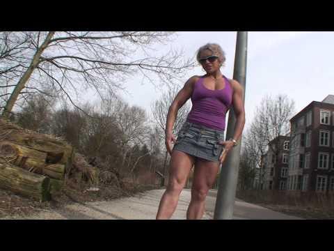 Female Bodybuilder Ella, from Romania, flexing her muscles