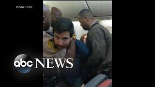 Chaos aboard flight as police use stun gun to arrest, remove passenger - ABCNEWS