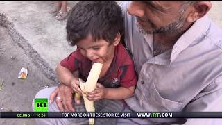 Food For Thought: First taste of fruit for some children after siege in Deir ez-Zor - RUSSIATODAY