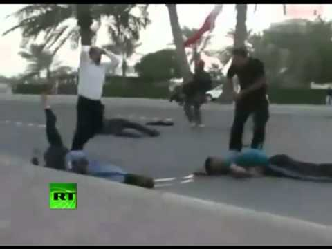 Graphic amateur video  Protesters injured in Bahrain as troops open fire