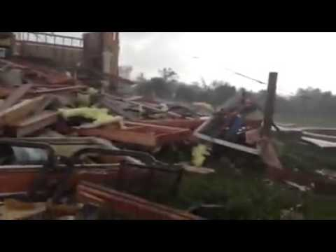 Family comes out of storm cellar after May 20th Tornado in Moore Oklahoma