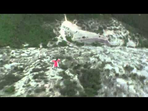 Wingsuit BASE Jumping 3 feet away from a cliff