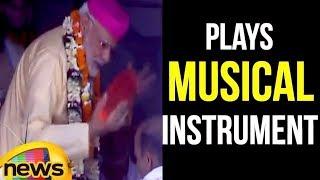 PM Modi plays musical instrument during visit to Janaki temple in Nepal   Mango News - MANGONEWS