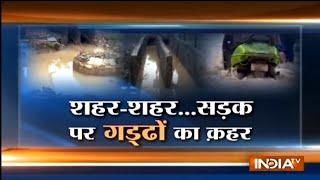 Haqiqat Kya Hai: Open manhole in Faridabad traps vehicles, endangers over a dozen lives - INDIATV