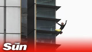 French spiderman free climbs one of Paris' tallest buildings LIVE - THESUNNEWSPAPER