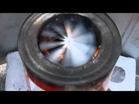 Spinning pinwheel on batch load TLUD woodgas stove to reduce soot