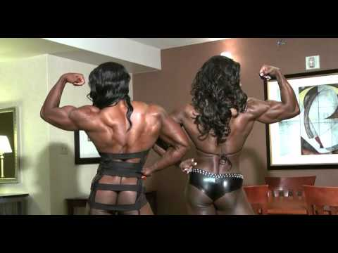 Black Massive Female Bodybuilder posing and flexing her huge rock hard muscles