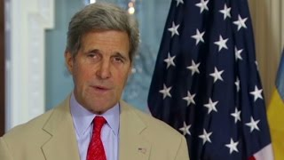 Kerry slams rebels for crash site behavior - CNN