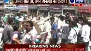 BJP activists throwing chairs at each other, shown black flags - ITVNEWSINDIA