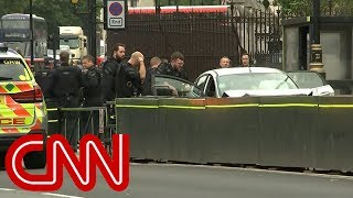 Car crashes into barrier outside UK parliament, man arrested - CNN